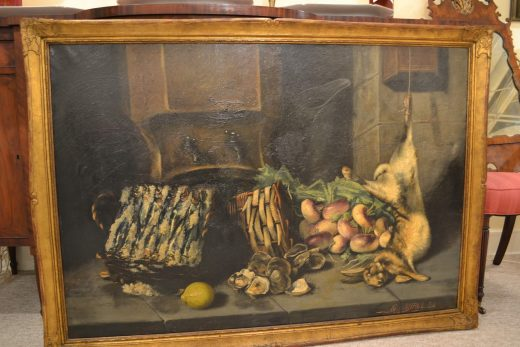 "This large, 40"" by 55"", French oil on canvas offers  promising options for the dinner table.  Below a typical French cistern and pewter pitcher are fish, game, shellfish, and the necessary lemon. Interestingly, a close view with raking light shows by hidden underlying texture that this is the second painting on the canvas by an artist who had a new idea and decided to save  a canvas. The frame is pleasant choice with a soft gilt surface and molded corners. A charm for the dining room or kitchen, $1250."