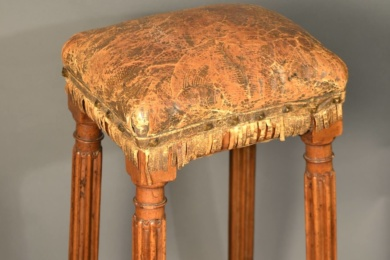 A 17th century walnut high stool.