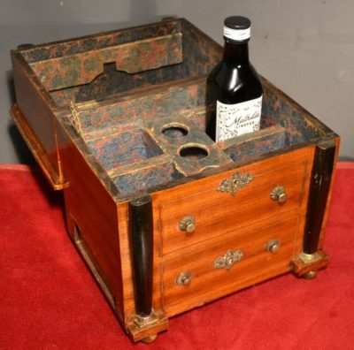 French Empire bureau conceals a a traveling liquor case, circa 1810 open