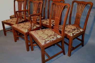 Seven mahogany chippendale style chairs