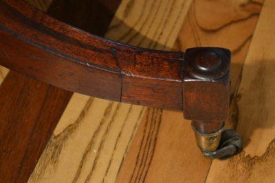 English regency mahogany inlaid breakfast table foot detail