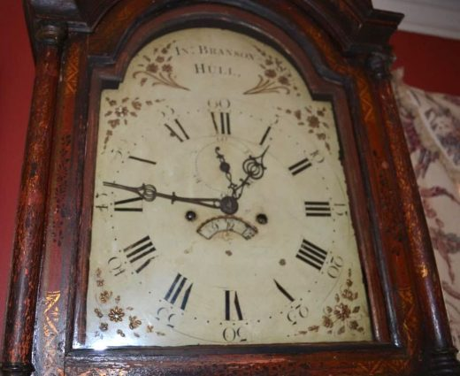 lacquered tall case clock face