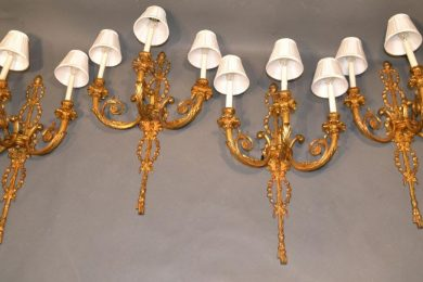 Louis XVI style gilt bronze sconce in a set of four