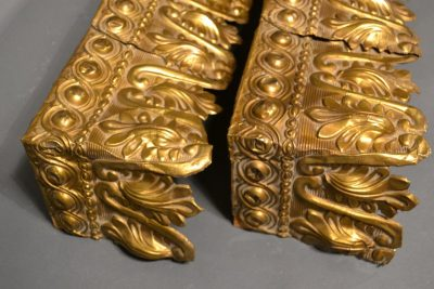 Empire type gilt stamped brass window valances side detail